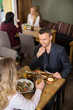 Businessman Having Food With Female Colleague