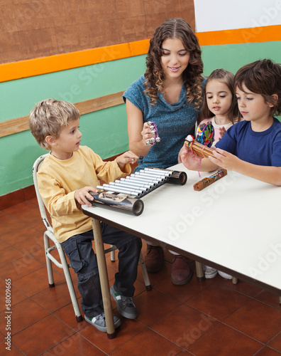 Teacher Playing Musical Instruments With Children