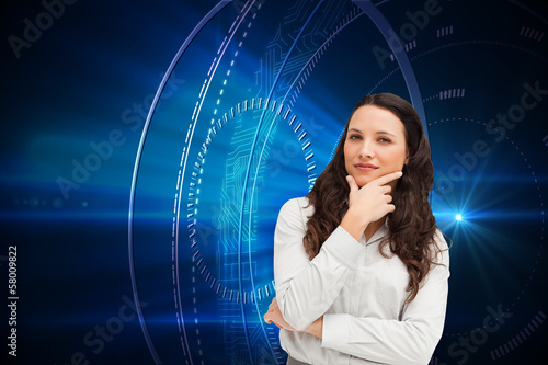 Composite image of portrait of a businesswoman posing