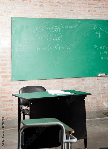 Classroom With Greenboard And Furniture