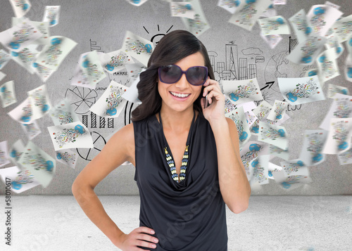 Composite image of happy brunette phoning