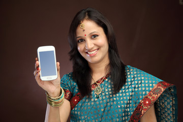 Young traditional woman showing picture of herself
