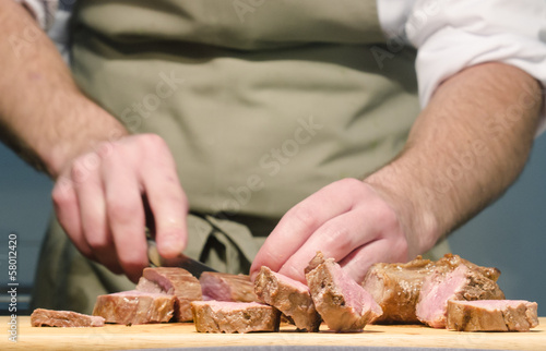 chef cutting steaks