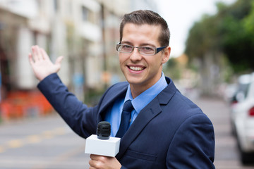 news reporter in live broadcasting on street