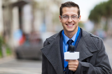 news reporter working in a cold weather