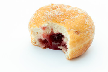 Jam donut with a mouthful taken out and jam showing