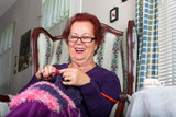 Senior Woman Knitting Happily