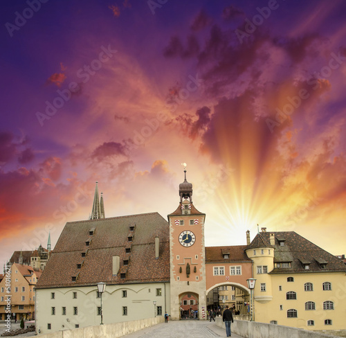 Beautiful sunset sky over medieval city skyline. Middle-Age buil