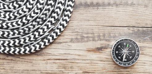marine roll ropes and chain on wooden background
