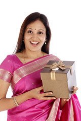 Surprised traditional woman holding gift box
