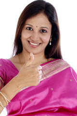 Traditional young Indian woman showing thumbs up