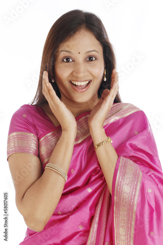 Excited young Indian woman against white