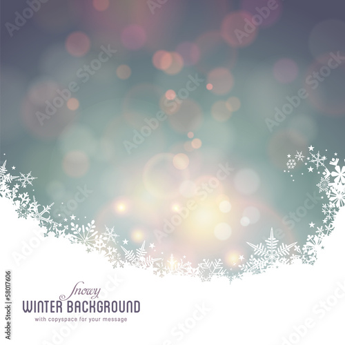 snowy winter background with defocused lights