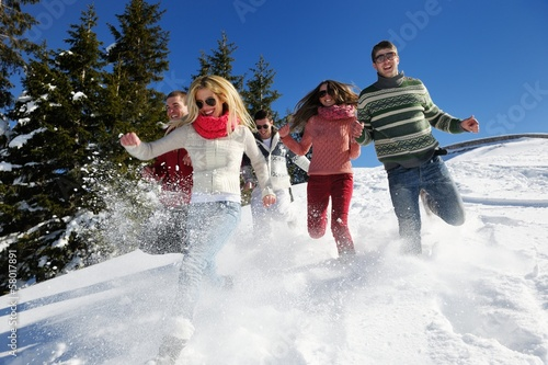 friends have fun at winter on fresh snow - 58017891