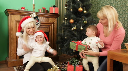 Children and their parents waiting for Christmas
