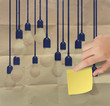 hand holding sticky note with another idea light bulb on crumple