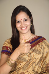 Young traditional woman showing thumbs up