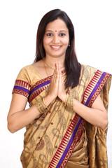 "Traditional Indian woman greeting ""NAMASTE"""