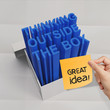 thinking outside the box on crumpled sticky note paper as concep