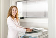 Businesswoman using photocopier in office