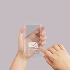 hand use Touch screen mobile phone with email icon as concept