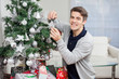 Man Smiling While Decorating Christmas Tree