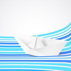 Paper ship on blue waves.