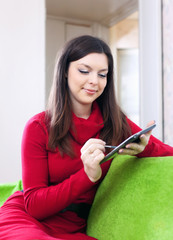 woman  with tablet computer or electronic book