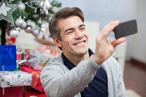 Man Taking Self Portrait Through Smartphone