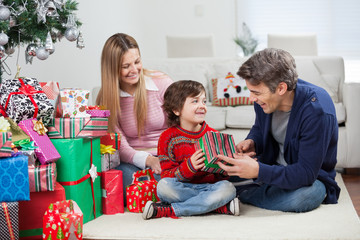 Happy Family With Christmas Gifts