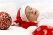 Portrait of sleeping little santa claus