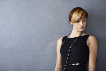 Elegant young woman in black dress