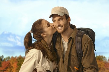 Couple hiking together in nice autumn weather