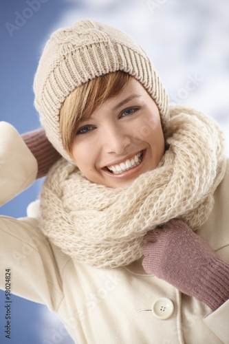 Happy young woman enjoying sunny winter day