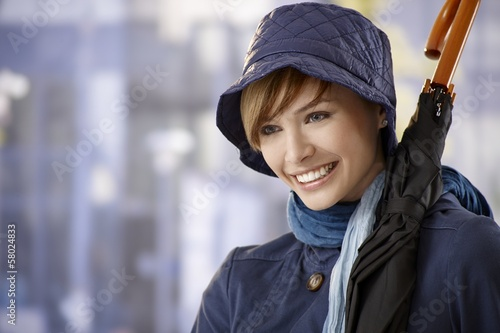 Attractive young woman with umbrella