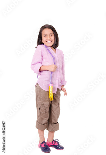 Seven years Girl with skipping rope isolated on white