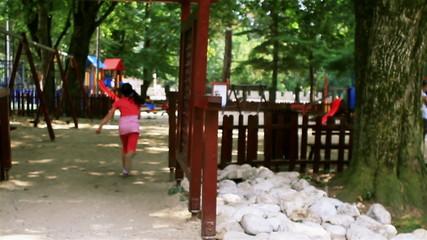 Little girl running to playground