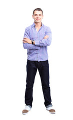 Full length portrait of a stylish young man with arms crossed