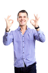 Happy man with thumbs up gesture