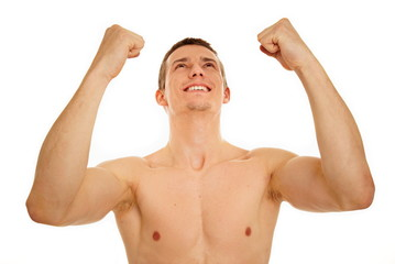 Athletic young man shows enthusiasm with hands up over head