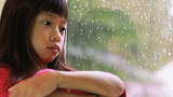 Little Asian Girl Depressed On A Rainy Day