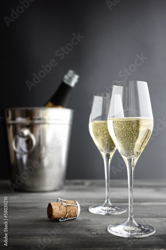 Fotobehang Wijn Two glasses of champagne, Cooler and Cork