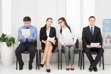 Four different people waiting for interview