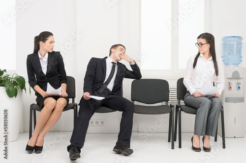 Group of people waiting for interview.