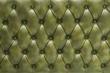 Superficie tapizada de cuero acolchado verde