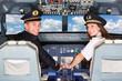 Leinwanddruck Bild - Pilots in the Cockpit