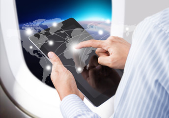Businessman  in airplane pressing social network communication