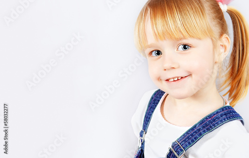 Portrait of a cute little girl with blue eyes