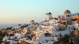 Sunset in Oia village on Santorini island, Greece.