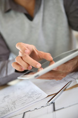 Closeup of man's hand using digital tablet